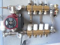 Коллектор с расходомерами на 6 выходов с насосом для водяного теплого пола в сборе.